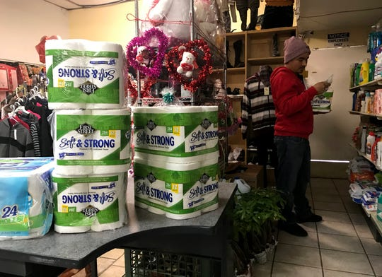 Luis Barajas looks for bath tissue at Fruteria La Mexicana in Salinas on Saturday, March 21, 2020. The store is selling 12 rolls of First Street Soft & Strong toilet paper for $16.50.