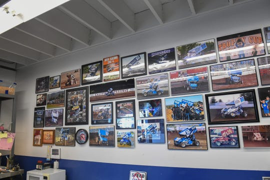 Pictures from years of racing line a wall of the workshop for Keith Day Racing. March 19, 2020.