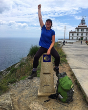 Haylee Oliver celebrates after reaching the final kilometer marker during a 34-day pilgrimage through Spain on the Camino de Santiago.