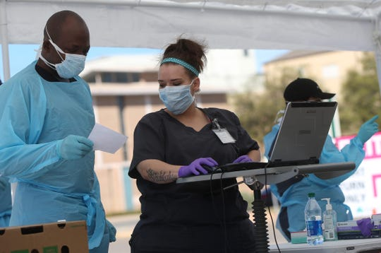 Health care professionals at Shannon Medical Center screen and test individuals for coronavirus Tuesday, March 24, 2020.