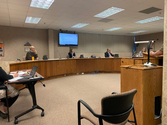 Minnehaha County Commission practices social distancing at its meeting March 24, 2020, by spreading out chairs for attendees and moving apart their own chairs.