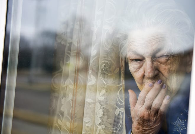 Marie DeBoer, 92, blows a kiss goodbye to her family on Monday, March 23, 2020 at Edgewood Assisted Living in Sioux Falls. Assisted living facilities across the city are limiting visitors to prevent the spread of COVID-19.