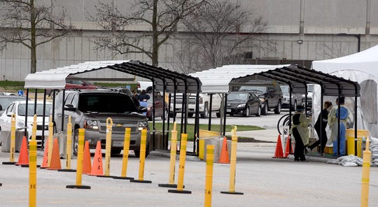 Drivers of more than two dozen vehicles line up Monday at the MU Covid-19 mobile drive-through testing station in the parking lot on the east side of the Hearnes Center to be tested for the Cover-19 virus.