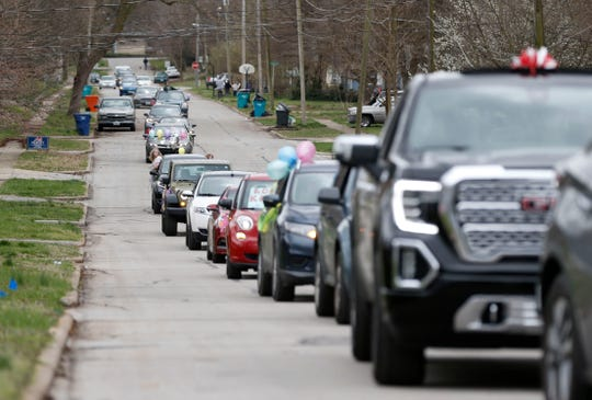 Teachers from Robberson Elementary drive through the neighborhood around the school in a parade to let their students know they miss them on Monday, March 23, 2020.