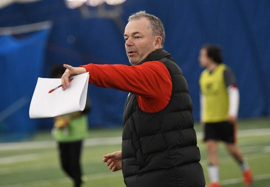 St. Cloud State men's soccer coach Sean Holmes directs players during an open tryout Thursday, March 5, 2020, at the Husky Dome.