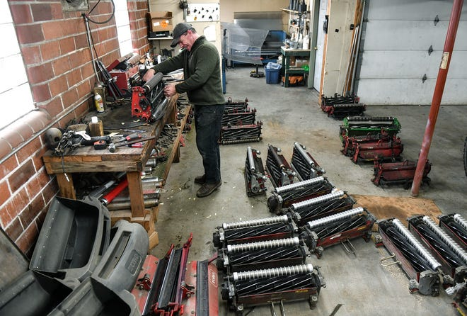 CEO and head superintendent Wes Fenlason sharpens reels for mowers in preparation for the coming golf season Tuesday, March 24, 2020, at Blackberry Ridge Golf Club in Sartell.