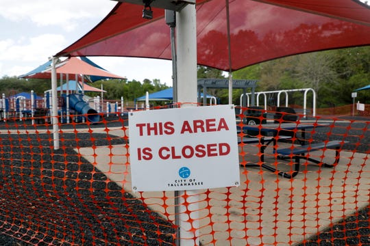 The playground area at Tom Brown Park is closed off Tuesday, March 24, 2020.