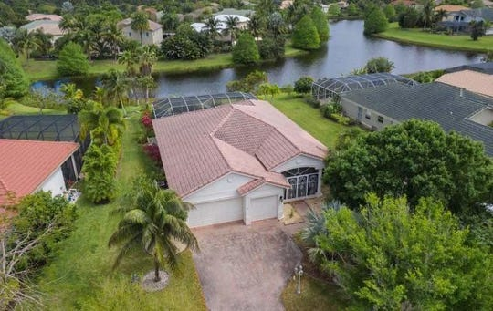 This 2,437-square-foot waterfront in Hammock Creek in Palm City goes up for auction at 6 p.m. Wednesday.