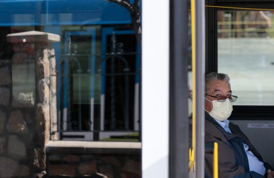 A Sun Metro passenger protects himself from COVID-19 as he takes the Brio to the westside from Downtown El Paso.