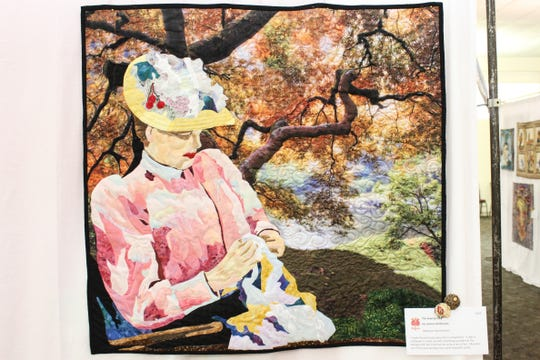 """The Sewing Lady,"" a quilt by Janina Hartmann, was among the quilts on display for this year's ""A Garden of Quilts,"" presented by Garden Patch Quilters and scheduled to be held at Wheaton Arts and Cultural Center, which was canceled because of COVID-19 transmission concerns."