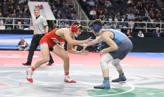 Eastchester's Tommy Dell'Aera (right) wrestles Chenango Forks' Logan Gumble in the opening round of the NYSPHSAA Tournament at the Times Union Center in Albany, N.Y.