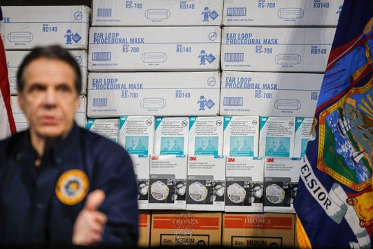 New York Gov. Andrew Cuomo speaks during a news conference against a backdrop of medical supplies at the Jacob Javits Center that will house a temporary hospital in response to the COVID-19 outbreak, Tuesday, March 24, 2020, in New York.
