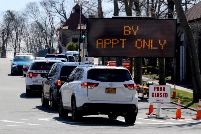 Drivers line up to enter the COVID-19 testing site Glen Island in New Rochelle, N.Y. March 24, 2020. Only those with appointments were allowed on to the site.