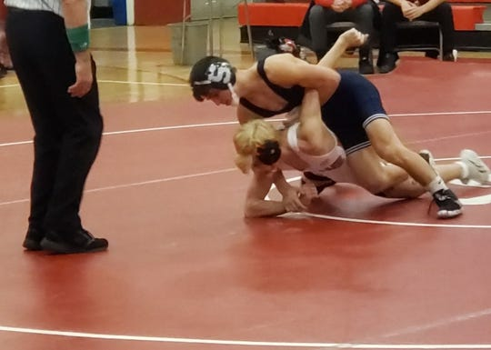 Suffern's Timmy Fay (top) wrestles at a meet in Fox Lane.