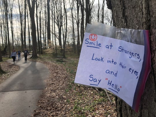 One of several messages posted along Glasgow Park's trail.