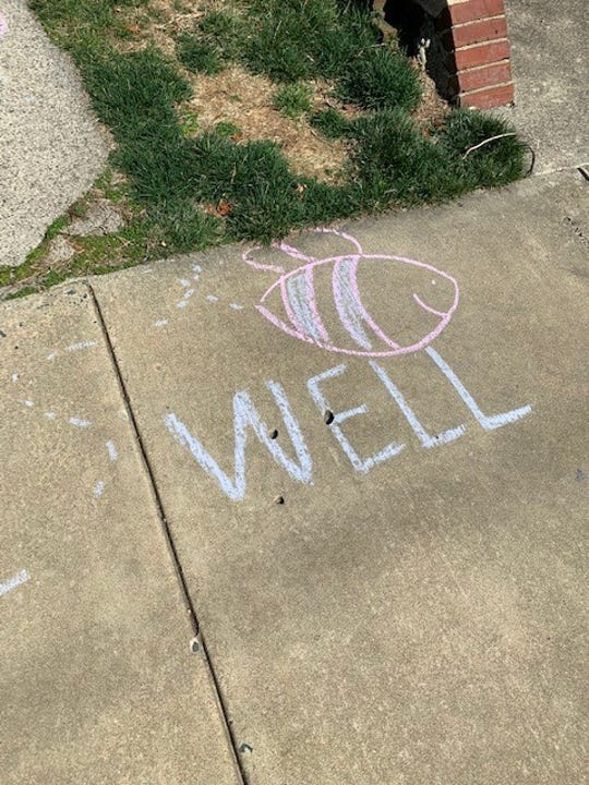 """""""Bee well"""" was one of the messages left using chalk Jennifer Fenstermacher and Valerie Stieler distributed throughout their Wilmington neighborhood during the first week of Delaware's state of emergency."""