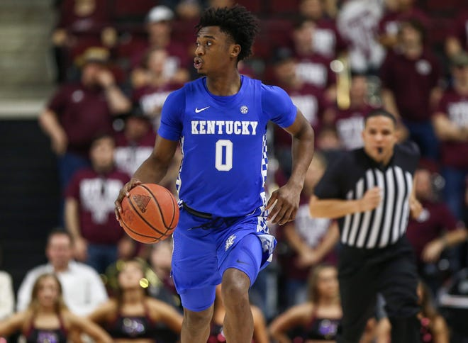 Kentucky Wildcats guard Ashton Hagans (0) dribbles the ball during the first half against the Texas A&M Aggies.