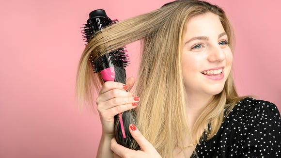 The Revlon One Step was easy to use and got our tester's hair dry and straight in under 30 minutes.
