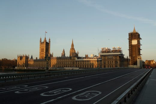 An almost empty Westminster Bridge normally a very busy river crossing as the sun rises in London, March 24, 2020. Britain's Prime Minister Boris Johnson on Monday imposed its most draconian peacetime restrictions due to the spread of the coronavirus on businesses and gatherings, health workers begged for more gear, saying they felt like