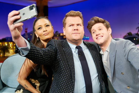 'The Late Late Show' host James Corden, center, takes a selfie with guests Thandie Newton, left, and Niall Horan after one of his signature group interviews on the late-night talk show.