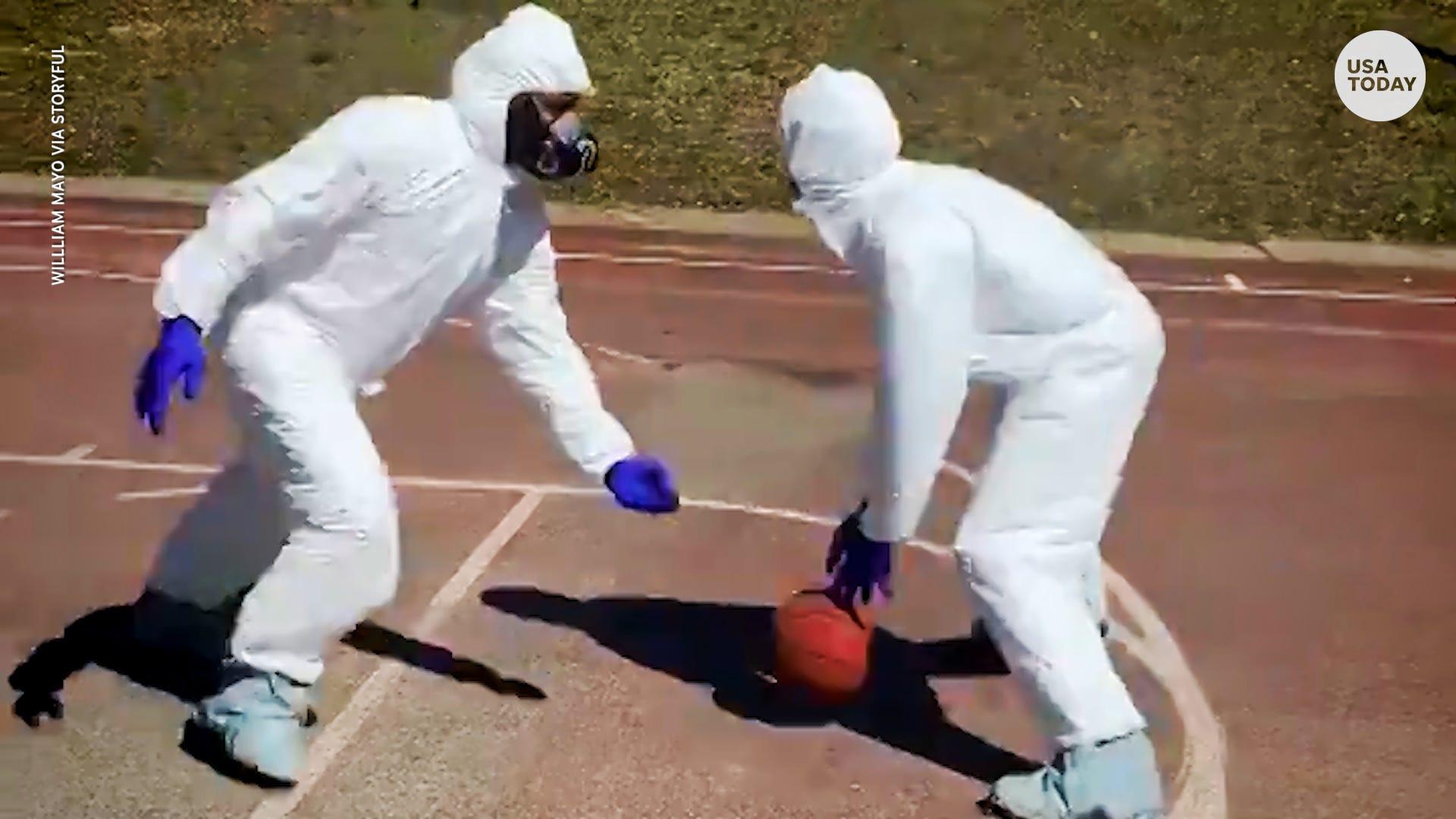 Coronavirus: New York group plays basketball in hazmat suits