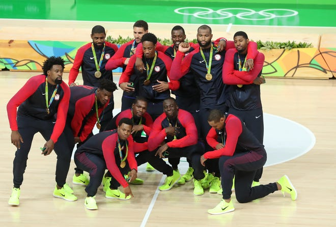 Team USA celebrates after winning the gold medal in men's basketball during the Rio 2016 Summer Olympic Games.