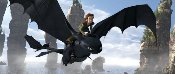 "Hiccup (voiced by Jay Baruchel) and buddy Toothless fly high in ""How to Train Your Dragon."""