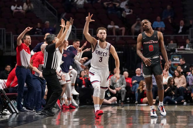Saint Mary's Gaels guard Jordan Ford (3) celebrates after making the game-winning basket against Pepperdine Waves guard Sedrick Altman (0) during the second overtime during the WCC Basketball Championships at Orleans Arena.