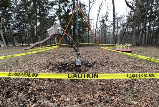 Caution tape creates a border around playground equipment at Hatten Park on March 25 in New London.