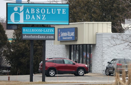 "Absolute Danz is closed in Menasha while Sherwin-Williams next door remains open under current ""Safer at Home"" guidelines that took effect Wednesday morning."