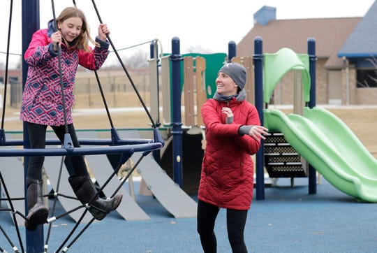 Alexis Allen, 10 plays with mother Sarah Allen at Erb Park in Appleton on March 23.