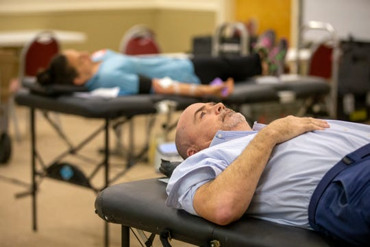 John Sullivan of Spring Lake donates blood at American Red Cross in Tinton Falls, NJ Wednesday, March 25, 2020.