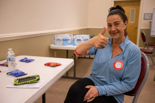 Denise Cali of Middletown gives a thumbs up after donating blood at American Red Cross in Tinton Falls, NJ Wednesday, March 25, 2020.