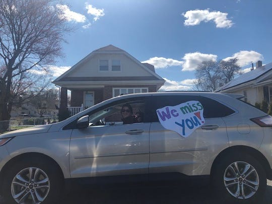 Gables Elementary School teachers waved to students and honked their horns in a car parade around the Gables section of Neptune Tuesday, March 24, 2020.