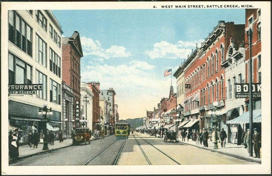 Color postcard showing a photo of West Main Street (now West Michigan Avenue), c. 1920.