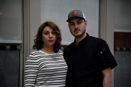 Sarah Barney-Davis and husband Tony Davis, owners of Kitchen Proper in Battle Creek, stand outside the restaurant in downtown Battle Creek on Tuesday, March 24, 2020.