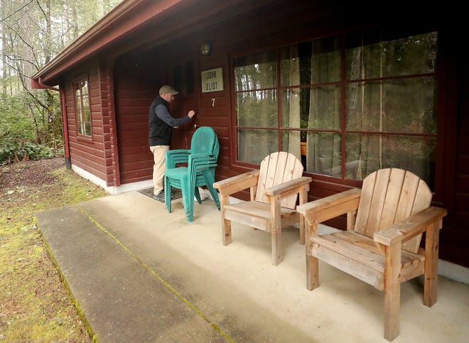 Wade Zick, managing director of Pilgrim Firs Camp & Conference Center, opens the John Eliot Cabin on Wednesday, March 25, 2020. The cabin will be used as an isolation center for first responders, medical personnel or those without shelter who need a place for isolation for COVID-19.