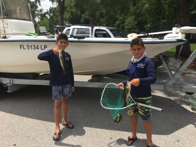 Indialantic brothers ChuChu Ramsaran, 9, left, and Gio Ramsaran, 10, scored two firsts in the Florida Flyrod Club when they tied for the Mister Panfish award in the Sports Angler division along with being the youngest winners in the club's 47 years. To share the title, each had a total of 15.3 pounds of panfish during the club's 2019 tournament season. They also caught bass, as shown in the photo.  The brothers  started fly fishing in the club tournaments last March, usually with their father Andy Ramsaran or with club member Lee Haskins.