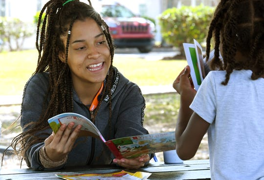 Club Esteem member Jalyna Maestre, 16, tutoring A'nyla Dennard, 7. Adults and teens of Club Esteem, Inc. are set up outside the Lipscomb Park Community Center on Monroe Street in South Melbourne, providing free breakfast and lunch meals for pick up with the help of Second Harvest Food Bank of Brevard and The Children's Hunger Project. They are set up 10am-1pm Mon-Fri , and hope to continue the meals in the coming weeks. Their mission is to inspire young people from economically disadvantaged communities to pursue academic and personal excellence. This non-profit is always in need of donations. Visit www.clubesteem.org.