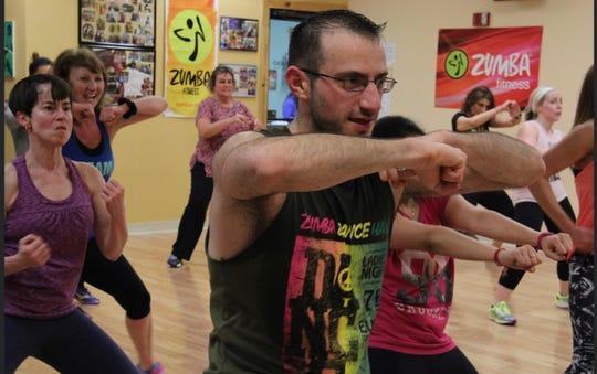 Dillon Reuben teaches a Zumba class at HammerFit in Essex. With nonessential businesses shut down due the coronavirus pandemic, Rueben has taken his weekly high-energy fitness class online.
