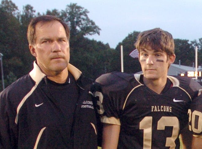 Burlingotn Township head football coach Tom Maderia, his son TJ Maderia pose for a photo before a game with Willingboro in 2009. TJ Maderia was hired as head coach at Holy Cross on Wednesday, a position his father held from 1992 to 2001.