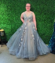 Mazie Mulford, a Woodstown High School senior, at a recent fitting of her prom gown amid uncertainty that her May 28 prom will be held. The dress is still at Jan's Boutique in Cherry Hill, closed as a nonessential business along with thousands of others during the statewide stay-at-home order to prevent the spread of coronavirus.
