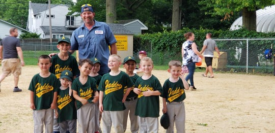 Steve Radie smiles with his tee-ball team, including John Marandola (next to Radie). Radie's efforts on a community Facebook page helped the Marandola family while John battled brain cancer.