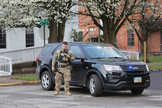 Police surround former city councilman Michael Mearan's home in Portsmouth, Ohio, on March 25, 2020.