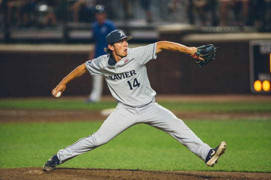 Lane Flamm lets fly for Xavier's Musketeers Photo by David Wegiel