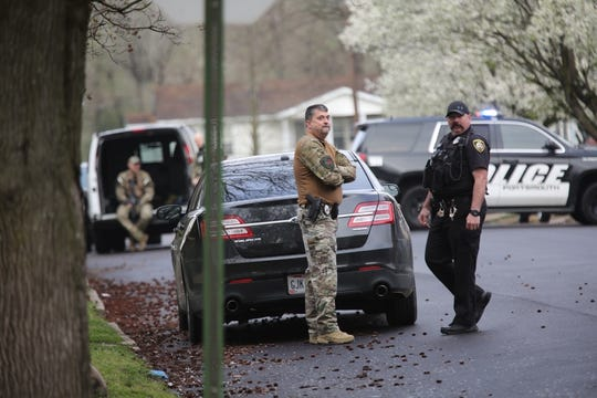 The streets surrounding Michael Mearan's home near the Scioto County Courthouse were blocked by police vehicles and flooded with police personnel on March 25, 2020.