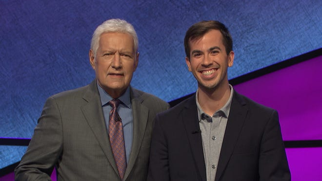 "Kyle Dallman, a political recruiter and trainer from Cincinnati, will compete on ""Jeopardy!"" on Monday. He is pictured with host Alex Trebek."