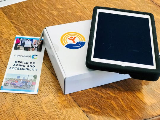 The iPads were delivered Monday by representatives from the City of Cincinnati and the United Way of Greater Cincinnati.