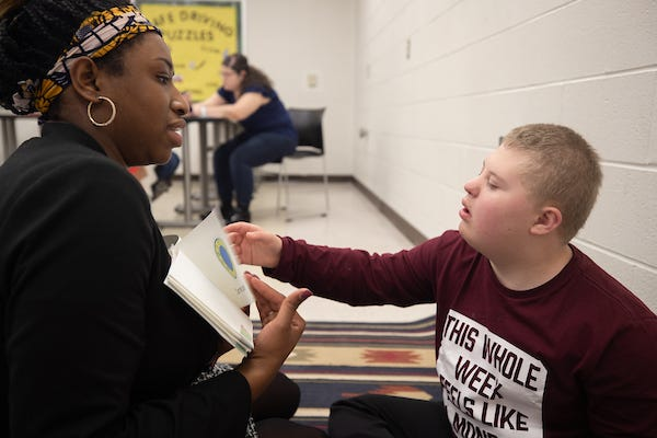 Speech-language student Isha Cheaye works with Caden at APSU.