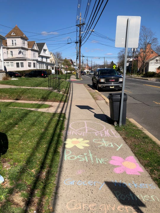 Sharing some smiles on a sidewalk as seen on Somerset Street in Raritan Borough.